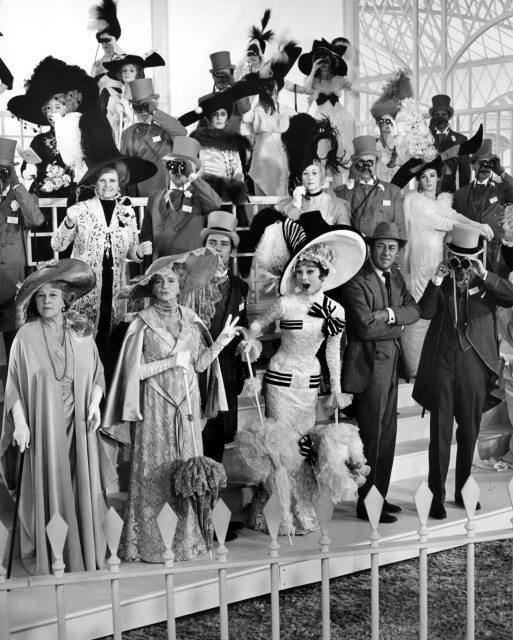 "The 1964 musical ""My Fair Lady"" was nominated for 12 Academy Awards® and won eight including Best Picture. Cast members Gladys Cooper (left), Jeremy Brett (center in top hat), Audrey Hepburn and Rex Harrison are shown here in scene still from the film's Ascot race. Restored by Nick & jane for Dr. Macro's High Quality Movie Scans Website: http:www.doctormacro.com. Enjoy!"